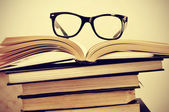 Books and eyeglasses — Stock Photo