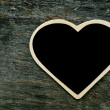 Heart-shaped blackboard — Stock Photo