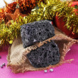 Christmas candy coal — Stock Photo