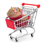Cupcakes in a shopping cart — Stock Photo