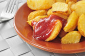 Typical spanish patatas bravas, fried potatoes with a hot sauce — Stock Photo