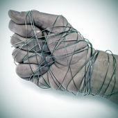 Man hand tied with wire — Stock Photo