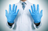 A doctor with medical gloves — Stock Photo