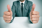 Man in suit giving a thumbs up signal — Stock Photo