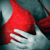 A man wearing a red lace bra — Stock Photo
