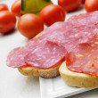 Bread slices with spanish salchichon and chorizo — Stock Photo