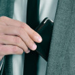 Man in suit taking out his wallet — Stock Photo #40304609
