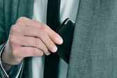 Man in suit taking out his wallet — Stock Photo