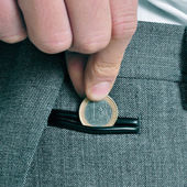 Man with euro coin — Stockfoto