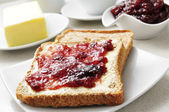 Coffee and toasts with butter and jam — Stock Photo