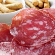 Slices of salchichon, spanish cured sausage — Stock Photo