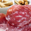 Slices of salchichon, spanish cured sausage — Stock Photo #43087867