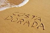 コスタ ・ ドラーダ砂に書かれました。 — ストック写真