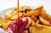 Home fries with ketchup — Stock Photo