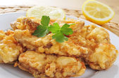 Spanish rape rebozado, battered and fried angler — Stock Photo
