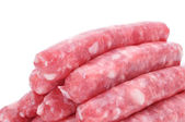 Uncooked pork meat sausages — Stock Photo