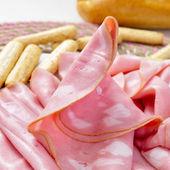 Slices of mortadella and bread sticks — Stock Photo