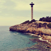 Lighthouse in Torredembarra, Spain, with a retro effect — Photo