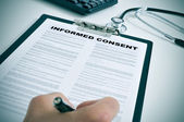 Signing an informed consent — Stock Photo