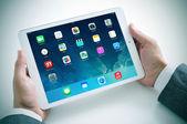 Businessman using the new iPad Air — Stock Photo