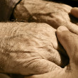 Young man holding the hands of an old man — Stock Photo #47192427