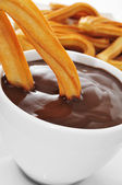 Churros con chocolate, a typical Spanish sweet snack — Stock Photo