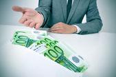 Man taking an envelope full of euro bills — Stock Photo