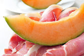 Spanish jamon serrano and melon — Stock Photo