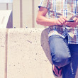 Young man using a smartphone outdoors — Stock Photo #48643355