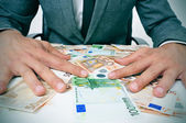 Man in suit with euro bills — Stock Photo