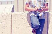 Young man using a smartphone outdoors — Foto de Stock