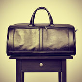 Leather bag on a table, with a retro effect — Stock Photo