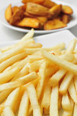 French fries and home fries — Stock Photo