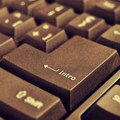 Intro key of a computer keyboard, with a retro effect — Zdjęcie stockowe