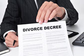 Lawyer showing a divorce decree — Stock Photo