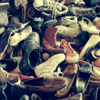 Second hand shoes in a flea market, with a retro filter effect — Stock Photo #50076171