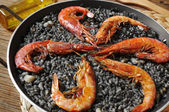 Spanish arroz negro, a typical rice casserole made with squid in — Stock Photo