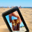 A tablet on the sand of a beach — Stock Photo #50318041