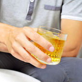 Young man hanging out with a glass of liquor — Stock Photo