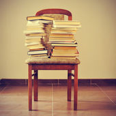 Books on a chair, with a retro effect — Stock Photo