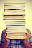 Man with books, with a filter effect — Stock Photo