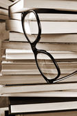 Books and eyeglasses, in black and white — Stock Photo