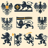 Heraldic lions and eagles — Vector de stock