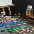 Stock Photo: Artist's paint palette and workspace.