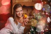 Beautiful woman and christmas tree — Stock Photo