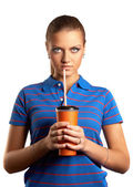 Young woman drinking from a paper cup — Stok fotoğraf