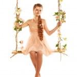 Beautiful girl swinging — Stock Photo