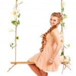 Beautiful girl swinging — Stock Photo #39433445
