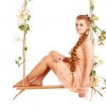 Beautiful girl swinging — Stock Photo #39433499