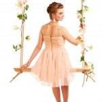 Beautiful girl swinging on white background — Stock Photo #40835489